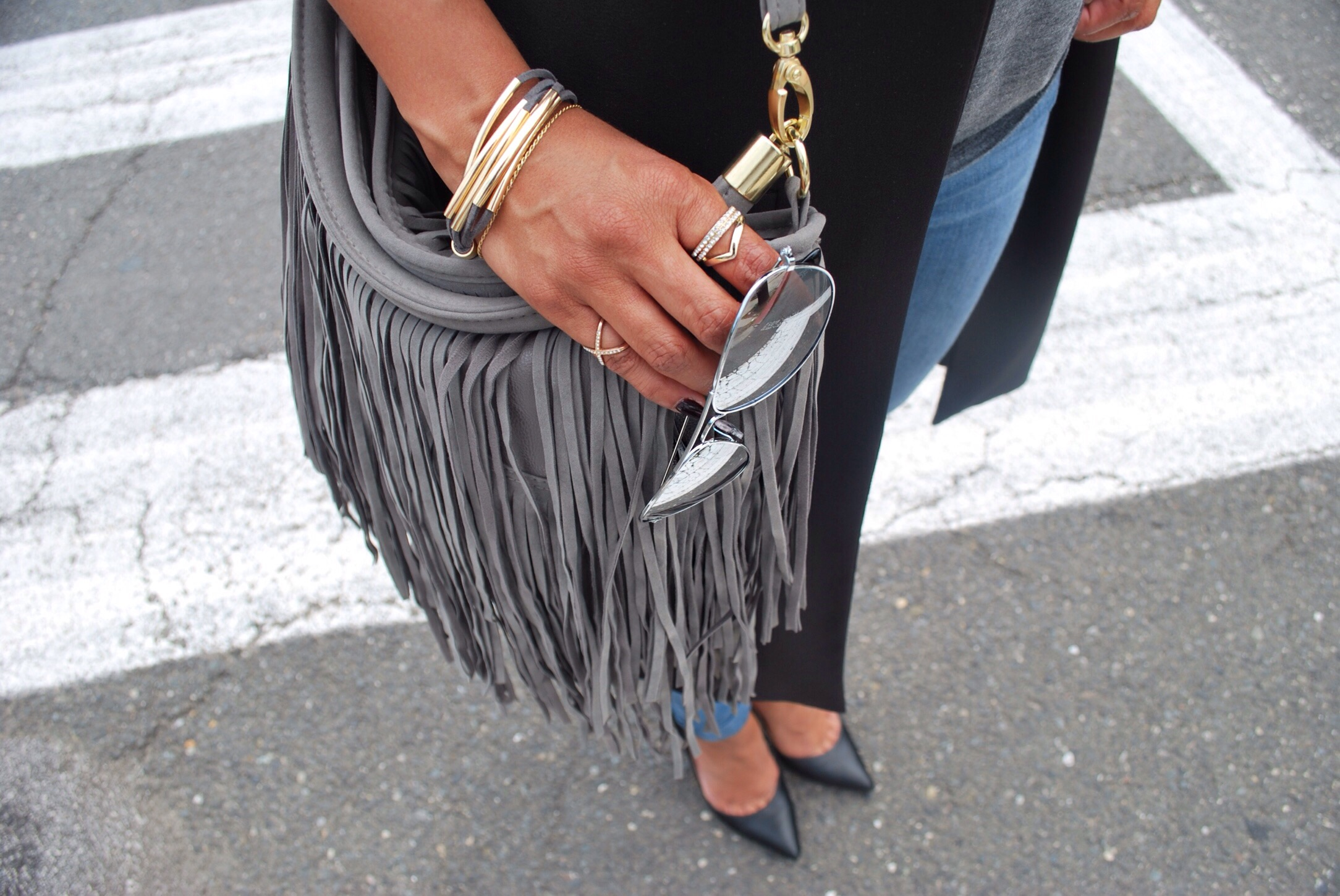 fringe bag and mirrored sunglasses