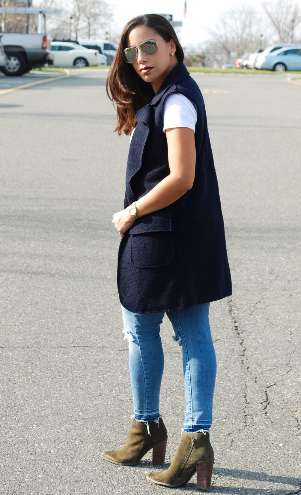 Navy vest and ankle boots